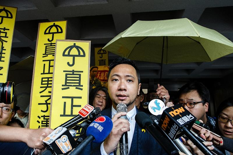 Hong Kong activist Ken Tsang (C) speaks to the press outside the High Court on March 21, 2017, before being jailed for assaulting police during the 2014 democracy protests after he dropped an appeal bid