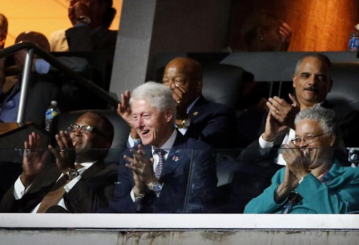 Bill Clinton reacts to Michelle Obama's speech at the Democratic National Convention. (Photo: Lucy Nicholson/Reuters)