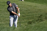 Bryson DeChambeau chips to the green on the ninth hole during the first round of the The Players Championship golf tournament Thursday, March 11, 2021, in Ponte Vedra Beach, Fla. (AP Photo/John Raoux)
