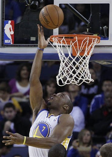 Golden State Warriors' Carl Landry scores against the during the first half of an NBA basketball game against the Atlanta Hawks Wednesday, Nov. 14, 2012, in Oakland, Calif. (AP Photo/Ben Margot)