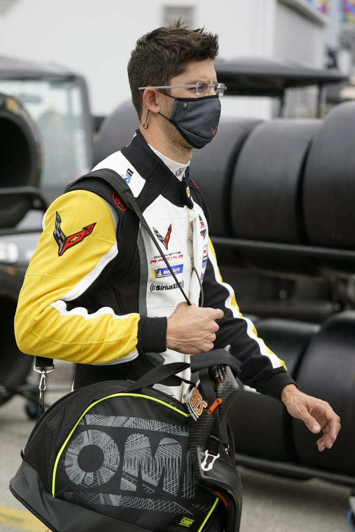 Jordan Taylor walks back to his garage after a practice session for the Rolex 24 hour auto race at Daytona International Speedway, Saturday, Jan. 23, 2021, in Daytona Beach, Fla. (AP Photo/John Raoux)