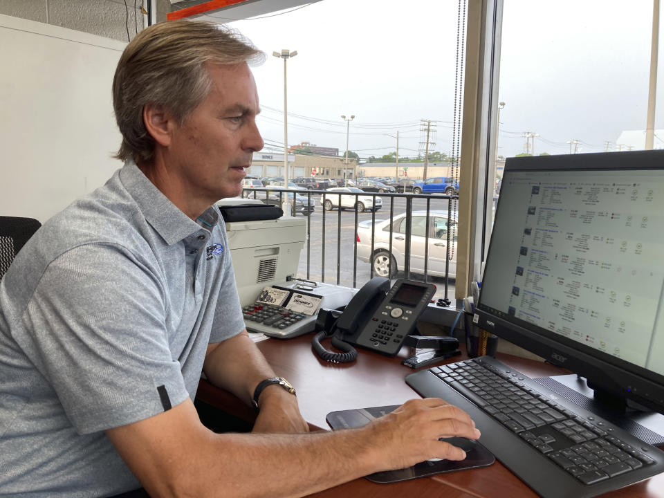 Paul Sugars, pre-owned sales manager, works on his computer at Jack Demmer Lincoln in Dearborn, Mich., on Monday, July 19, 2021. A seemingly endless streak of skyrocketing used vehicle prices is finally coming to a close in the U.S., according to the latest data (AP Photo/Mike Householder)