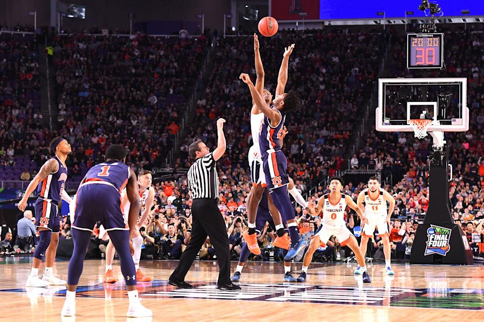 The Auburn Tigers tip off against the Virginia Cavaliers in the first half of the semifinal game in the NCAA Men's Final Four at U.S. Bank Stadium on April 06, 2019 in Minneapolis, Minnesota. (Photo by Brett Wilhelm/NCAA Photos via Getty Images)