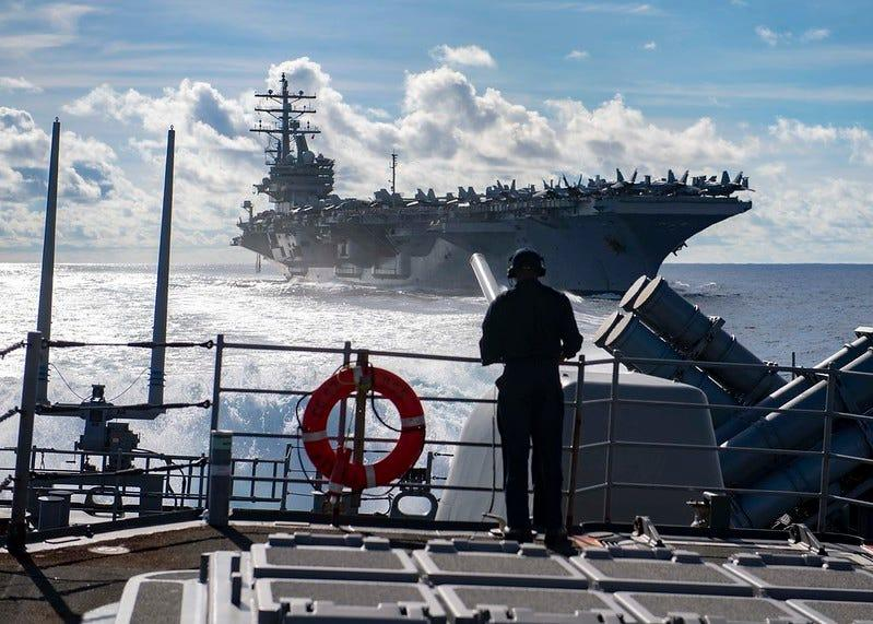 Seaman Marcus White, from San Diego, stands watch as aft lookout aboard the Ticonderoga-class guided-missile cruiser USS Chancellorsville (CG 62) during a replenishment-at-sea with the Nimitz-class aircraft carrier USS Ronald Reagan (CVN 76)