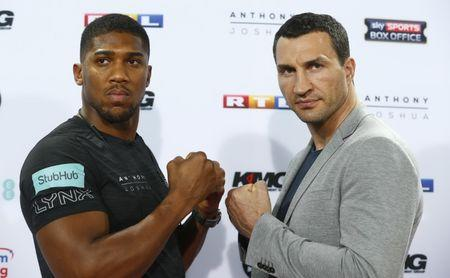 Anthony Joshua and Wladimir Klitschko pose during the press conference