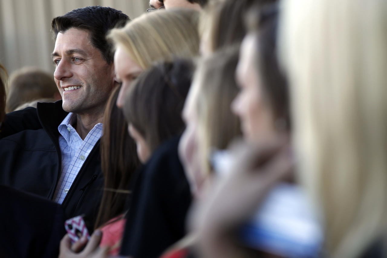 Republican vice presidential candidate, Rep. Paul Ryan, R-Wis., poses for pictures with supporters as he arrives at the Blue Grass airport, Wednesday, Oct. 10, 2012 in Lexington, Ky. (AP Photo/Mary Altaffer)