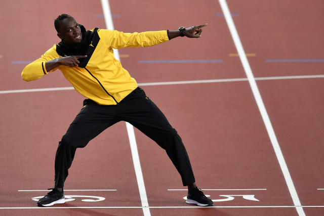 Jamaica's Usain Bolt preforms his trademark pose during a victory lap at the World Athletics Championships in London Sunday, Aug. 13, 2017. (AP Photo/Martin Meissner)