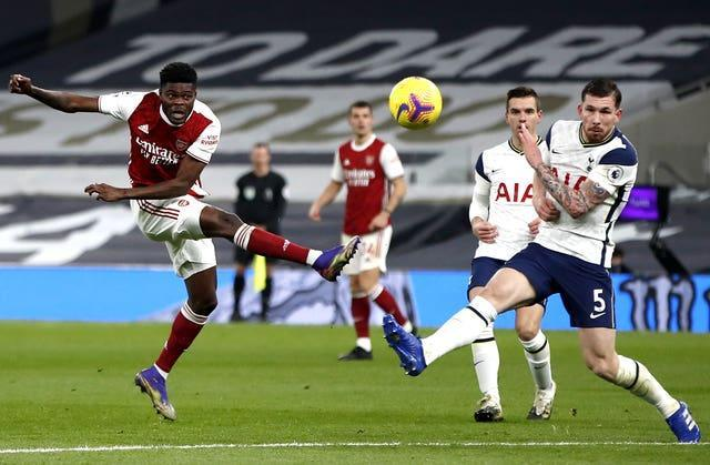 Arsenal's Thomas Partey in action against Tottenham