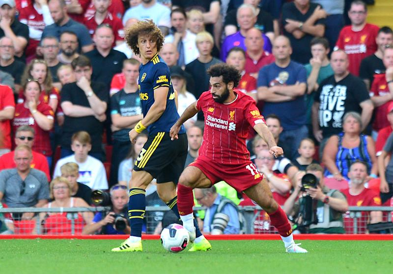 Arsenal's David Luiz (left) and Liverpool's Mohamed Salah battle for the ball during the Premier League match at Anfield, Liverpool. (Photo by Anthony Devlin/PA Images via Getty Images)