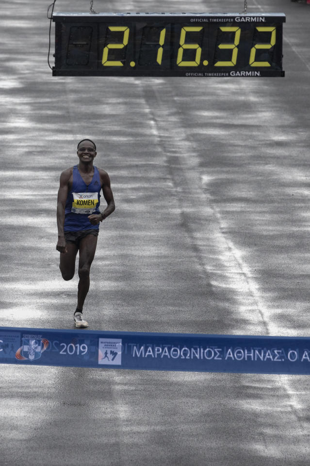 John Kipkorir Komen of Kenya runs to the finish line of the 37th Athens Marathon on Sunday, Nov, 10, 2019. The 42-year-old runner finished in a time of 2 hours, 16 minutes, 34 seconds, beating Rwanda's Felicien Muhitira, 17 years his junior, by nine seconds. (AP Photo/Yorgos Karahalis)
