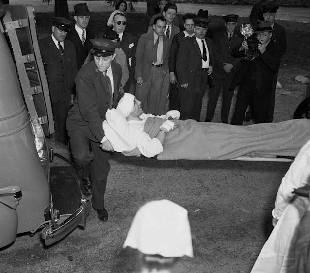 <p>Adolf Fisher, a mechanic of the German airship Hindenburg, is transferred from Paul Kimball Hospital in Lakewood, N.J., to an ambulance going to another area hospital, May 7, 1937. The Hindenburg exploded yesterday after mooring in Lakehurst Naval Air Station, killing 36 people. (AP Photo) </p>