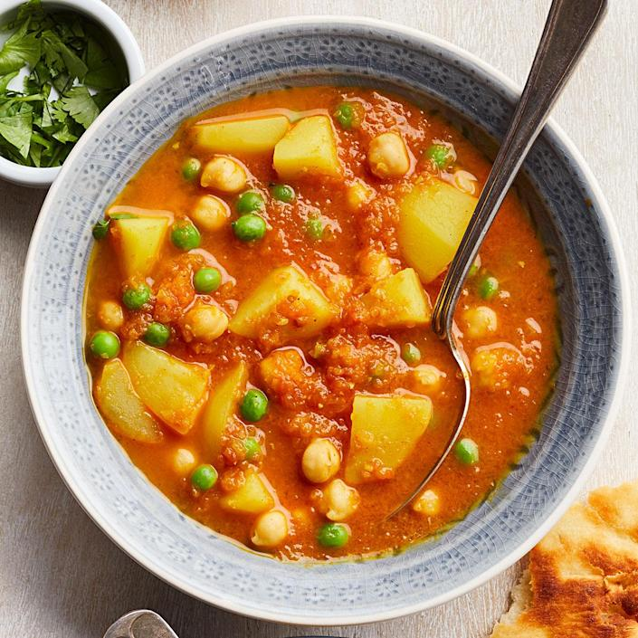 <p>This fast Indian-style curry comes together with ingredients you most likely have on hand, like frozen peas and canned tomatoes and chickpeas. Plus, using these spices shows how simple it is to make a curry sauce for an easy vegetarian recipe. Serve with whole-wheat naan to sop it all up.</p>