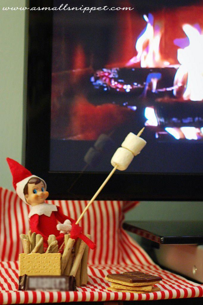 """<p>Here's something you may not know: You don't need a fire to make delicious, gooey s'mores! With the help of a digital Yule log, you're already halfway there.</p><p><strong>Get the tutorial at <a href=""""http://asmallsnippet.com/2013/11/45-elf-on-the-shelf-ideas-from-the-same-elf.html"""" rel=""""nofollow noopener"""" target=""""_blank"""" data-ylk=""""slk:A Small Snippet"""" class=""""link rapid-noclick-resp"""">A Small Snippet</a>.</strong></p><p><a class=""""link rapid-noclick-resp"""" href=""""https://www.amazon.com/Jet-Puffed-Marshmallows-16-Ounce-Bags/dp/B07HNXDH2V/ref=sr_1_4?tag=syn-yahoo-20&ascsubtag=%5Bartid%7C10050.g.22690552%5Bsrc%7Cyahoo-us"""" rel=""""nofollow noopener"""" target=""""_blank"""" data-ylk=""""slk:SHOP MARSHMALLOWS""""><b>SHOP MARSHMALLOWS</b> </a></p>"""