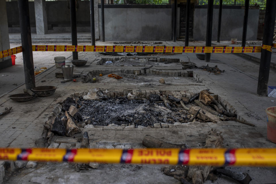 A pyre inside a crematorium where a 9-year-old girl from the lowest rung of India's caste system was cremated, earlier this week is secured by police, in New Delhi, India, Thursday, Aug. 5, 2021. Angry villagers held a protest saying the girl was raped and killed. (AP Photo/Altaf Qadri)