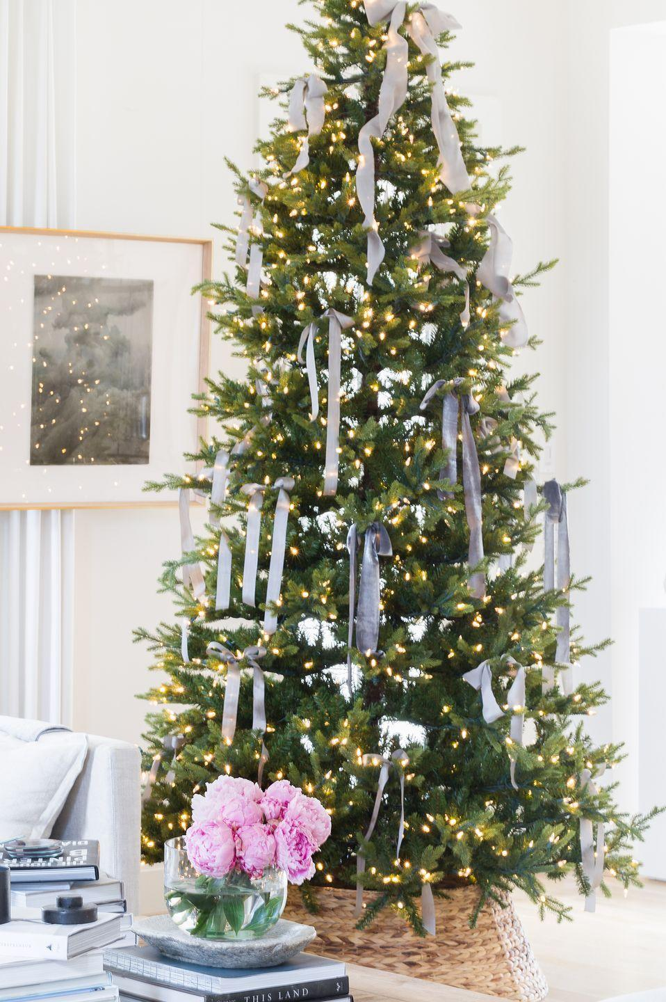 "<p>Switch things up without adding more work to your decorating agenda by exchanging ornaments for ribbons, like in this setup styled by <a href=""http://alyssarosenheck.com/"" rel=""nofollow noopener"" target=""_blank"" data-ylk=""slk:Alyssa Rosenheck"" class=""link rapid-noclick-resp"">Alyssa Rosenheck</a>. </p>"