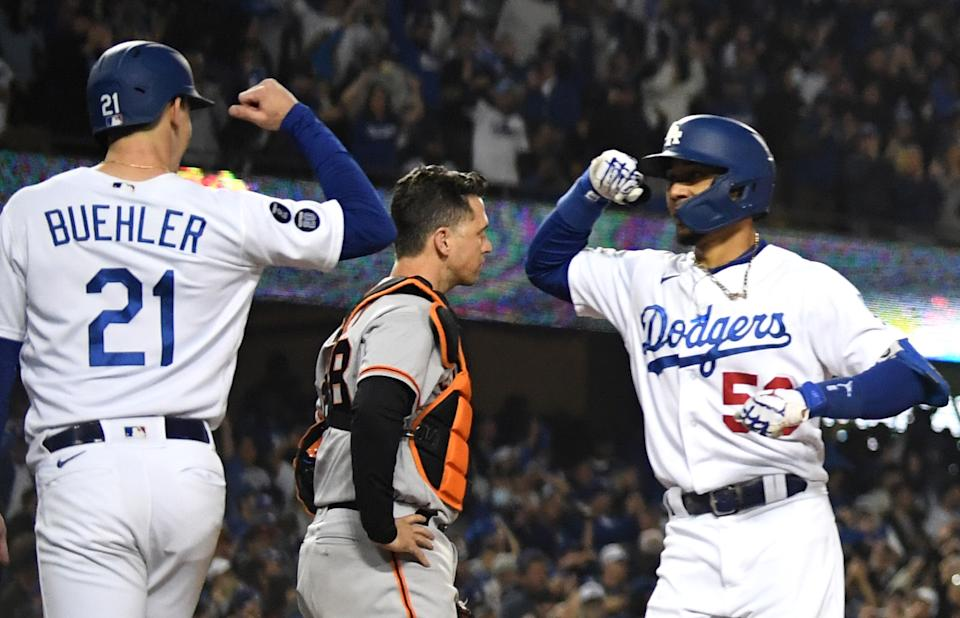 Mookie Betts and Walker Buehler celebrate Betts' home run in the NLDS. (Photo by Keith Birmingham/MediaNews Group/Pasadena Star-News via Getty Images)