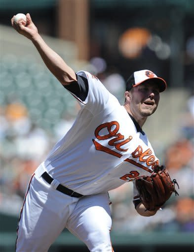Baltimore Orioles pitcher Tommy Hunter delivers against the Oakland Athletics during the first inning of a baseball game on Sunday, April 29, 2012, in Baltimore.(AP Photo/Gail Burton)