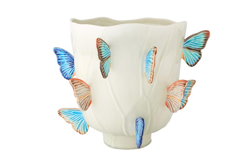 A vase adorned with butterflies from her collection with Bordallo Pinheiro.