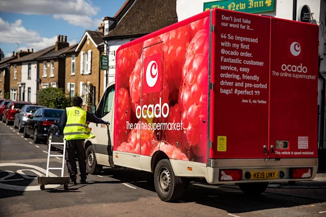 A Ocado delivery driver after dropping off food shopping outside a customer home during the Covid-19 pandemic. (PA)