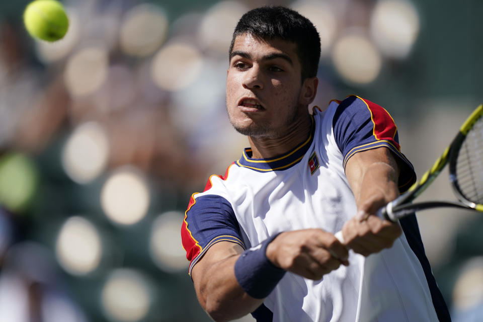 Carlos Alcaraz, of Spain, returns a shot to Andy Murray, of Britain, at the BNP Paribas Open tennis tournament Sunday, Oct. 10, 2021, in Indian Wells, Calif. (AP Photo/Mark J. Terrill)