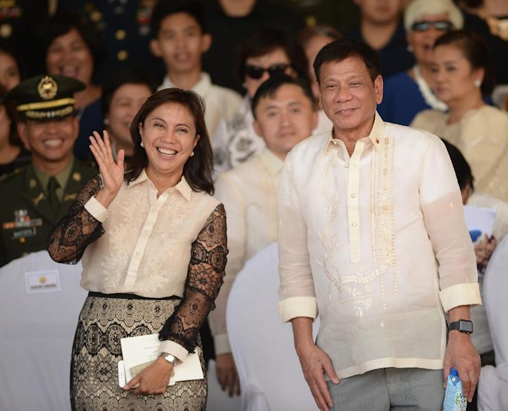 Philippines President Rodrigo Duterte (right) appointed Vice-President Leni Robredo to his cabinet on July 1 (AFP Photo/Ted Aljibe)