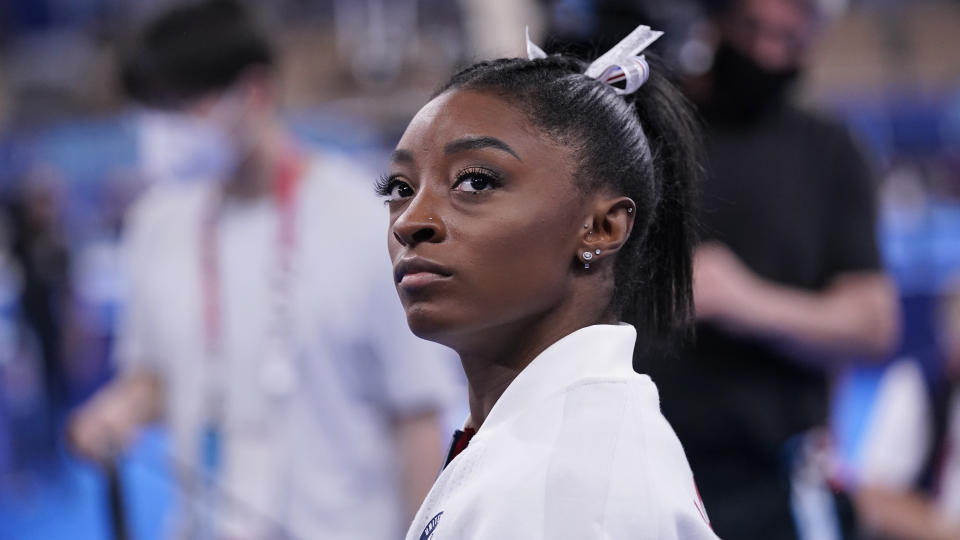 In a stunning turn of events, Simone Biles exited the gymnastics team competition in Tokyo. (AP Photo/Gregory Bull)