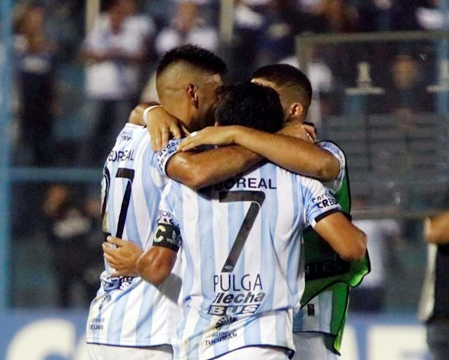 Soccer Football - Argentina's Atletico Tucuman v Uruguay's Penarol - Copa Libertadores - Monumental Jose Fierro stadium, Tucuman, Argentina - May 2, 2018 - Atletico Tucuman's players celebrate at the end of the match. REUTERS/Sol Almidez