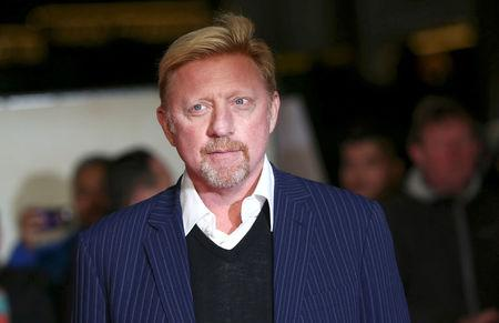 "FILE PHOTO: Former tennis player Boris Becker poses for photographers at the world premiere of the film ""I am Bolt"" in London"