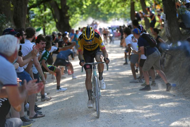 SIENA ITALY AUGUST 01 Wout van Aert of Belgium and Team JumboVisma Dust Fans Public during the Eroica 14th Strade Bianche 2020 Men a 184km race from Siena to SienaPiazza del Campo StradeBianche on August 01 2020 in Siena Italy Photo by Tim de WaeleGetty Images