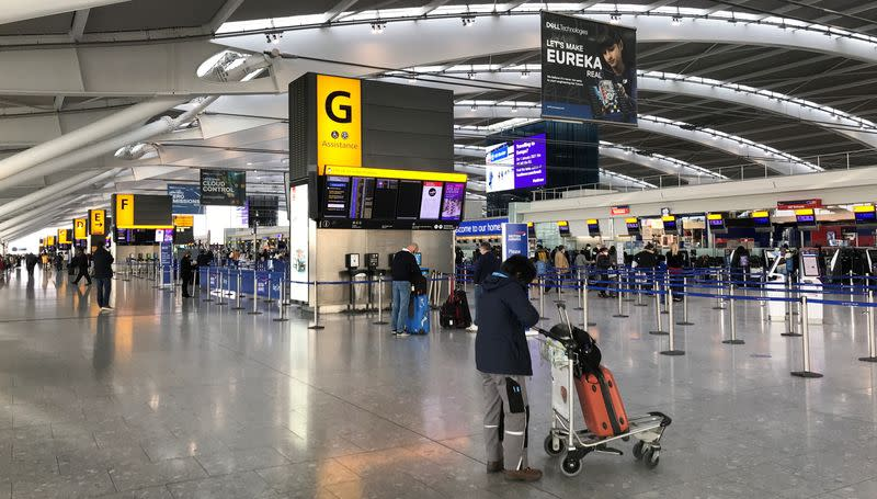 Passengers at BA check-in desks at Heathrow Airport in London