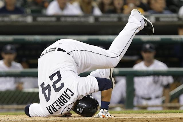 Detroit Tigers' Miguel Cabrera tumbles from a inside pitch from New York Yankees relief pitcher Dellin Betances in the ninth inning of a baseball game in Detroit, Wednesday, Aug. 27, 2014. The Yankees won 8-4. (AP Photo/Paul Sancya)