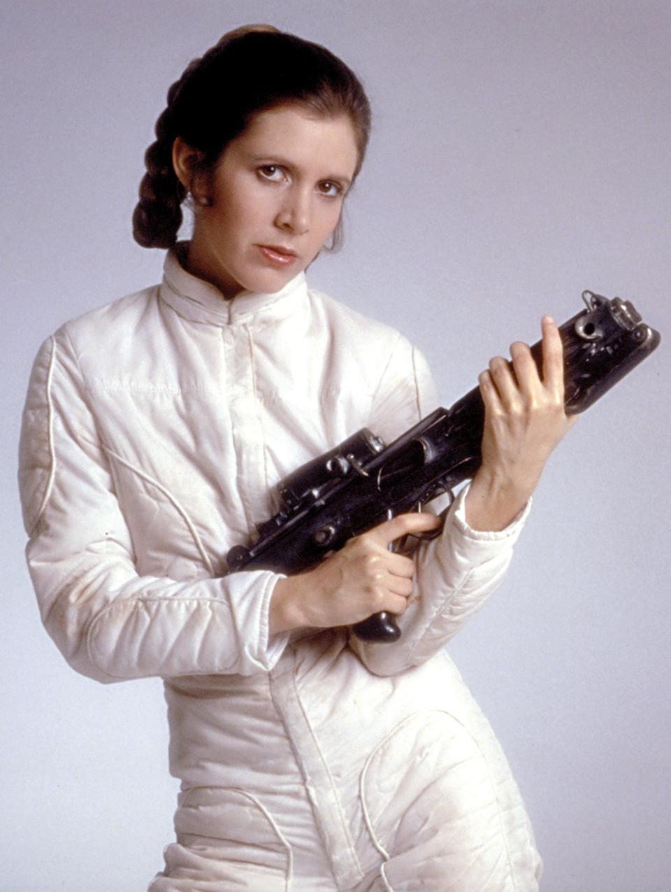 <ul> <li><strong>What to wear:</strong> A white jumpsuit, padding and faux blaster optional, with dark blue boots. Pull your hair back in a single braid.</li> </ul>