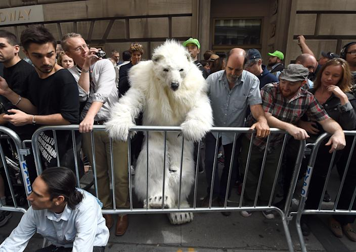 "A man dressed as a polar bear climbs a barricade as protestors take part in the ""Flood Wall Street"" demonstrations on September 22, 2014 in New York (AFP Photo/Timothy A. Clary)"