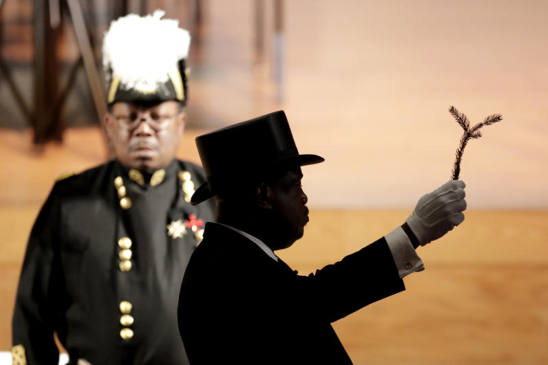 A member of the Most Worshipful Prince Hall Grand Lodge of Maryland holds up a branch during a ceremony for the late U.S. Rep. Elijah Cummings during a viewing service at Morgan State University, Wednesday, Oct. 23, 2019, in Baltimore. The Maryland congressman and civil rights champion died Thursday, Oct. 17, at age 68 of complications from long-standing health issues. (AP Photo/Julio Cortez)