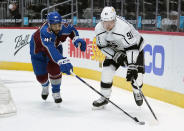 Colorado Avalanche center Pierre-Edouard Bellemare (41) steals the puck from Los Angeles Kings left wing Carl Grundstrom (91) during the first period of an NHL hockey game Wednesday, May, 12, 2021, in Denver. (AP Photo/Jack Dempsey)