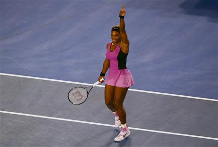 Serena Williams of the United States celebrates defeating Ashleigh Barty of Australia in their women's singles match at the Australian Open 2014 tennis tournament in Melbourne January 13, 2014. REUTERS/Petar Kujundzic