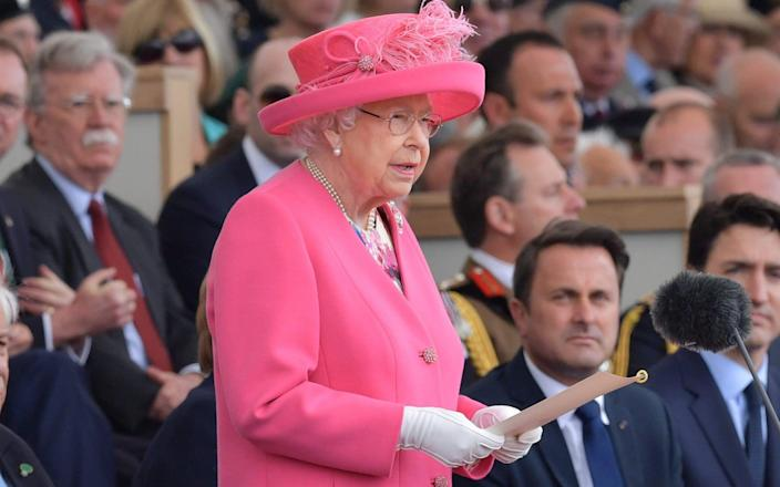Queen Elizabeth II stands to make her address during an event to commemorate the 75th anniversary of the D-Day landings - AFP