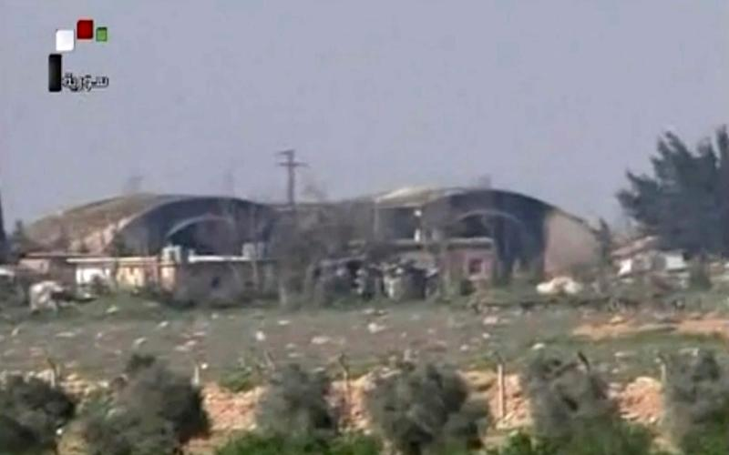 Burned and damaged hangars hit by US Tomahawk missiles, at the Shayrat Syrian government forces airbase, southeast of Homs - Credit: Syrian government TV