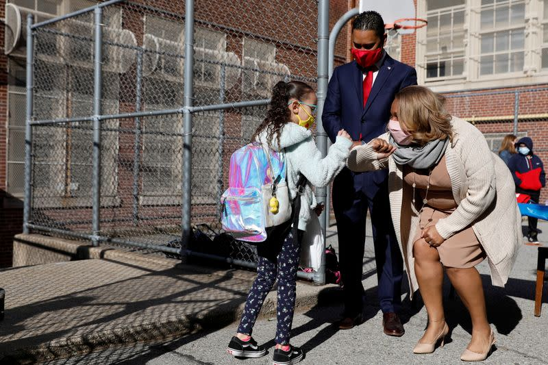 FILE PHOTO: Meisha Porter, Chancellor of the New York City Department of Education, greets students as they return to school in Manhattan, New York