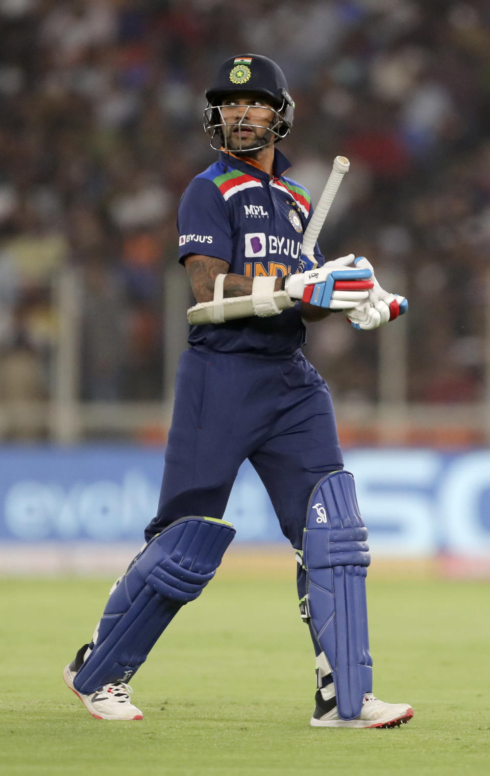 India's Shikhar Dhawan walks back after his dismissal during the first Twenty20 cricket match between India and England in Ahmedabad, India, Friday, March 12, 2021. (AP Photo/Aijaz Rahi)