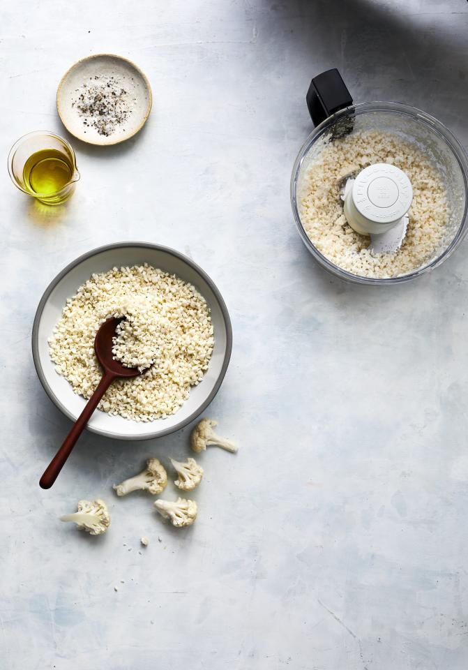 "<p>First things first. Making your own cauliflower rice is not only easy, it'll save you money, too. Thanks to your food processor, this simple method transforms a head of cauliflower into 6 cups of cauliflower rice, basically double what you'd get if you bought it pre-made. </p> <p><strong>Get the recipe</strong>: <a href=""https://www.realsimple.com/food-recipes/browse-all-recipes/cauliflower-rice-recipe"" target=""_blank"">Homemade Cauliflower Rice</a></p>"