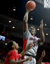 Arizona forward Stanley Johnson (5), right, shoots over Gardner Webb guard Adonis Burbage (23) during the second half of an NCAA college basketball game, Tuesday, Dec. 2, 2014, in Tucson, Ariz. (AP Photo/Rick Scuteri)