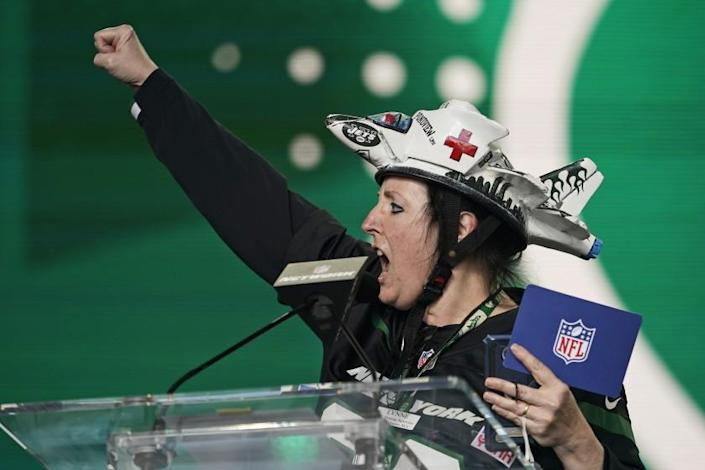 New York Jets fan of the year Lynne Pondview reacts after the Jets selected Michael Carter II, cornerback for Duke, in the fifth round of the NFL football draft, Saturday, May 1, 2021, in Cleveland. (AP Photo/Tony Dejak)