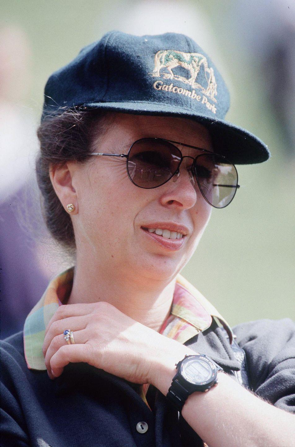 <p>At first glance, Princess Anne's engagement ring looks similar to the ring from her first marriage. However, it's actually quite unique. The center stone is a blue cabochon that's set with a trio of small diamonds on each side. </p>