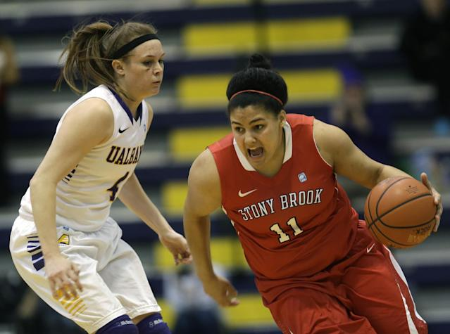 Stony Brook guard Kori Bayne-Walker (11) drives past Albany guard Sarah Royals (4) during the first half of an NCAA America East college championship basketball game on Monday, March 10, 2014, in Albany, N.Y. (AP Photo/Mike Groll)