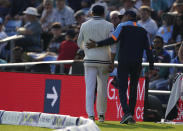 India's Ravindra Jadeja, left, goes off the field with a member of team support staff during the first day of third test cricket match between England and India, at Headingley cricket ground in Leeds, England, Wednesday, Aug. 25, 2021. (AP Photo/Jon Super)