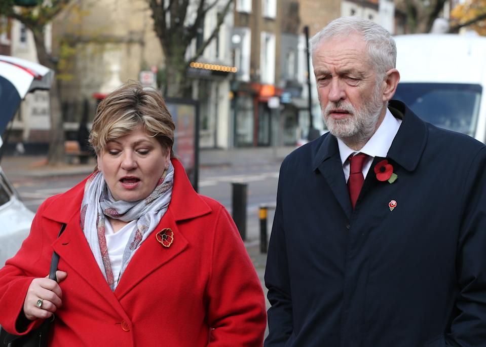 Shadow foreign secretary Emily Thornberry and Labour Party leader Jeremy Corbyn, walk together after observing a silence to mark Armistice Day, the anniversary of the end of the First World War, outside Islington Town Hall.
