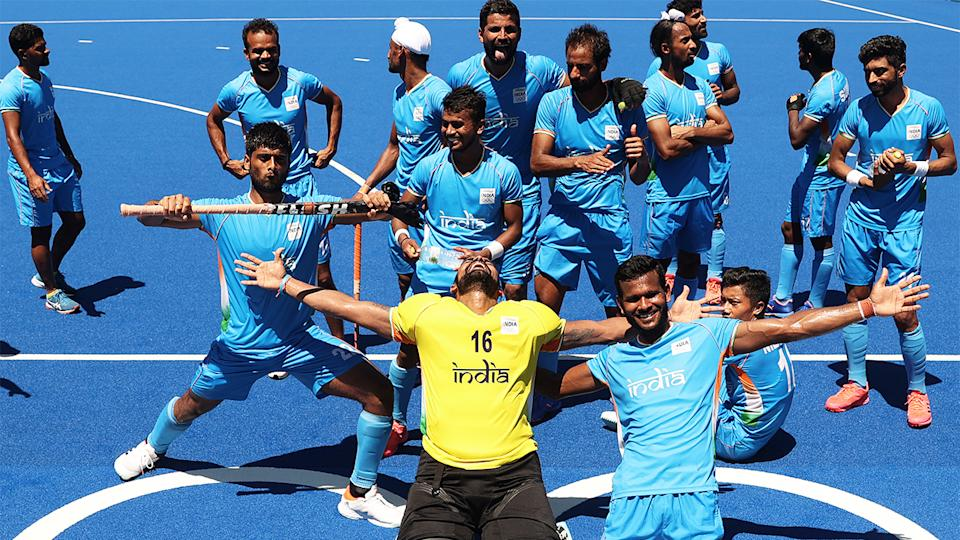 The Indian hockey team celebrate after winning bronze at the Tokyo Olympics.