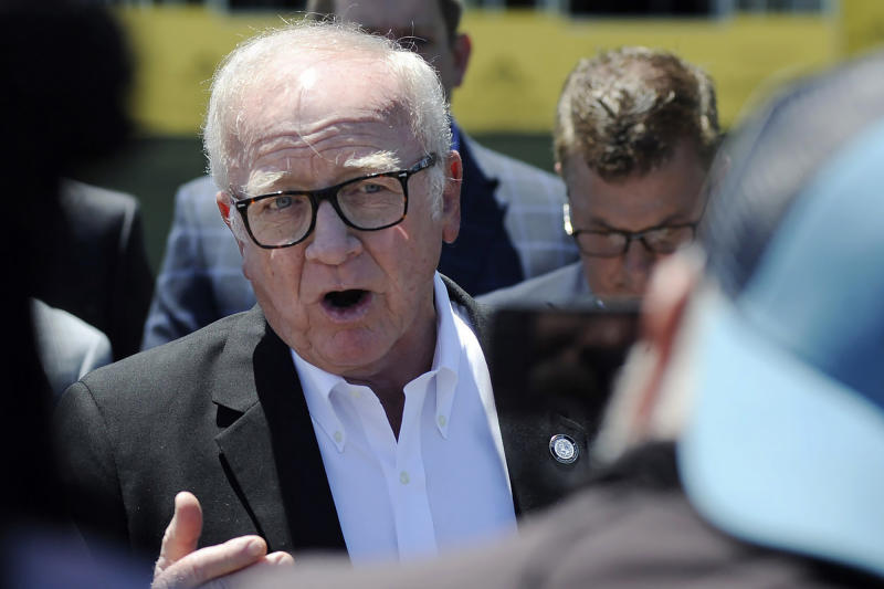 Harry Reeder, a Presbyterian pastor who opposes abortion, addresses the media outside the site of a new women's clinic being constructed by Planned Parenthood in Birmingham, Ala., on Thursday, June 13, 2019. The organization is working on the project despite a new state law that virtually bans abortion in Alabama, and critics say they hope to prevent the clinic from opening. (AP Photo/Jay Reeves)