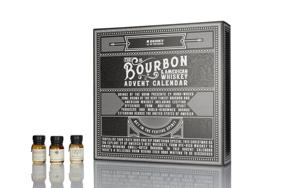 """<p><strong>Drinks by the Dram</strong></p><p>thespiritco.com</p><p><strong>$186.48</strong></p><p><a href=""""https://thespiritco.com/collections/advent-calendars/products/bourbon-and-american-whiskey-calendar"""" rel=""""nofollow noopener"""" target=""""_blank"""" data-ylk=""""slk:Shop Now"""" class=""""link rapid-noclick-resp"""">Shop Now</a></p><p><strong>Best for: </strong>The sipper who expresses their patriotism through booze.</p><p><strong>What's inside: </strong>24 samples of bourbon and American whiskey sourced from artisan brands and major names. Bonus: If you're inclined to more worldly tastes, the brand also offers <a href=""""https://thespiritco.com/collections/advent-calendars"""" rel=""""nofollow noopener"""" target=""""_blank"""" data-ylk=""""slk:a slew of other advent calendars"""" class=""""link rapid-noclick-resp"""">a slew of other advent calendars</a> from Scotch to rum to vodka and beyond. </p>"""